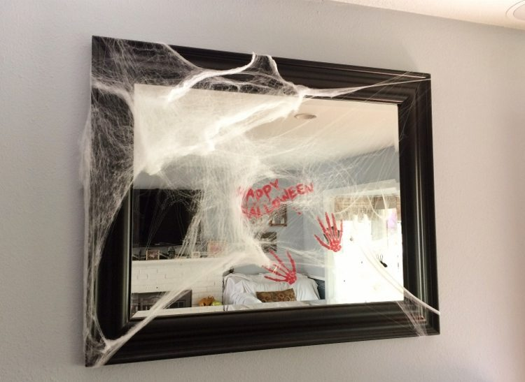 Spider webbed Covered Mirror