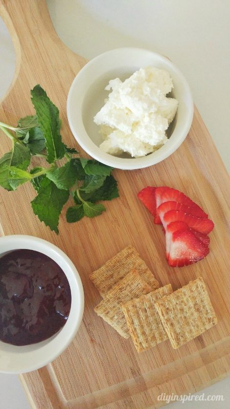 TRISCUIT Original Crackers, Whipped Cream Cheese, Strawberry Jam, Sliced Strawberry, Fresh Mint Leaf