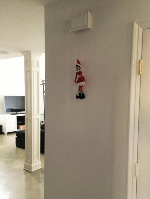 elf-on-the-shelf-ideas-on-a-picture-hanger